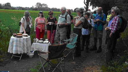 The Dereham group of Walkers are Welcome take a refreshment break between Mattishall and Dereham. Pi
