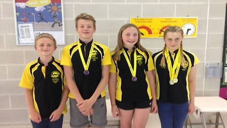 Dereham Otters swimmers, from left to right, Charlie Summer, Callum Steadman, Molly Monk and Ruby