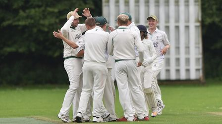 Swaffham celebrate claiming the wicket of Beccles' George Milton. Picture: Antony Kelly