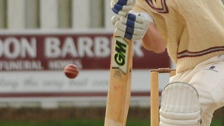 Jordan Taylor batting for Swardeston, with airborne bowler Sean McCabe for Norwich in the Carter Cu
