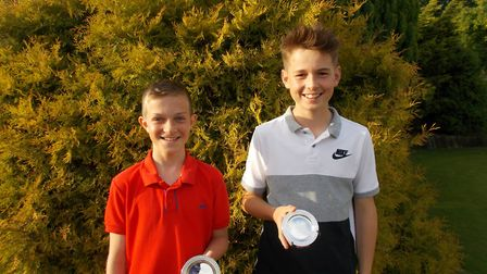 Hayden Lambert and Jude Marsden-Mooney are all smiles after their success at Dereham Golf Club. Pict