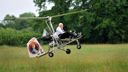 Wing Commander Ken Wallis taking off in one of his collection of autogyros at Reymerston. Photo: Bil