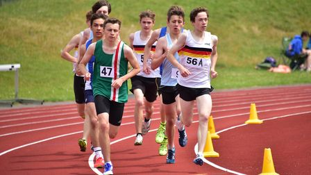 Anglian Schools Athletics Championships at the UEA Sportspark. Jack White (56A) leading the 1500m.Pi