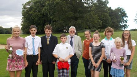 Successful golfers at the Dereham Junior Open with club president Mike Hopping. Pictured from left