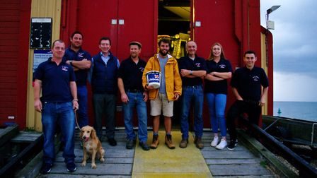 Alex Ellis-Roswell with the Wells lifeboat crew. Photo: RNLI