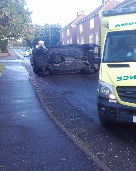 A car was left overturned after a collision on Sandy Lane. Picture: Jaff Chapman