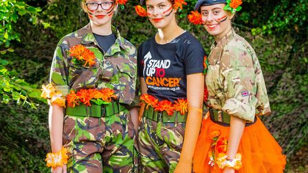 Dereham air cadets stand up to cancer. Pictured are cadets Gintar Kucinskaite, Maya Langford and Fl