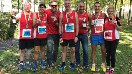 The Dereham Runners AC contingent have a champagne moment in Reims. Picture: James Nice