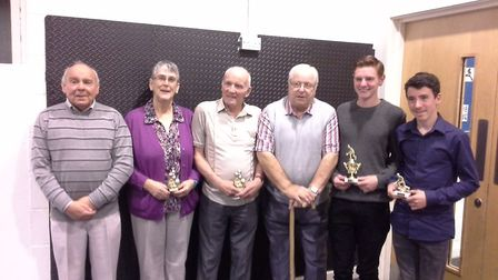 Dereham Indoor Bowls Club's singlesprize winners with chairman Arthur Mobbs (left) and president Rob