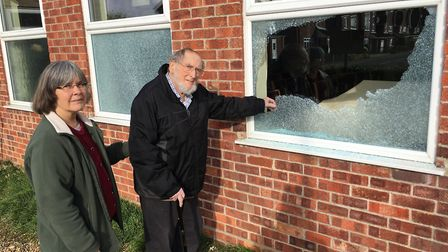 Joyce Gathercole and Bill Platten, in front of the broken windows at Toftwood Methodist Church. Pict