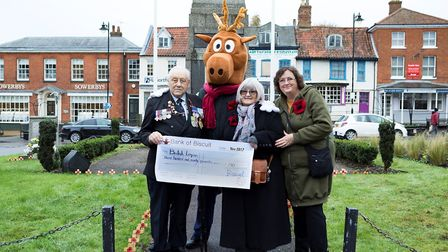 Dereham Carnival mascot Biscuit presents a cheque for £390 to John English, Dereham RBL Poppy Appeal