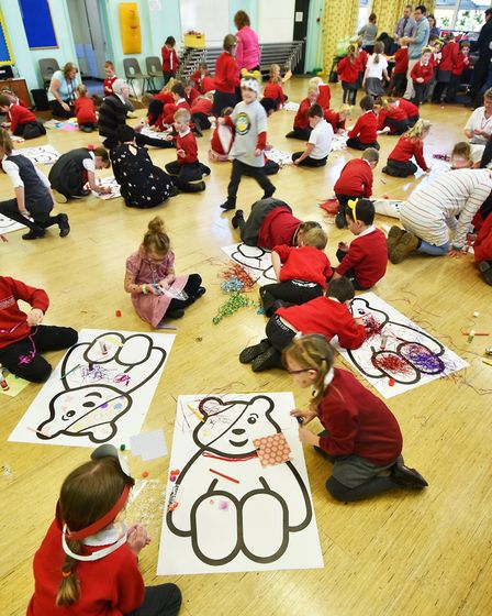 North Walsham Junior School pupils taking part in the Inspired Youth decorate a Pudsey Bear for Chil