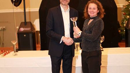 Craig Farr of Leathes Prior presenting Carol Devlin of Dereham Runners AC with her trophy. Picture: