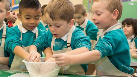 Richard Hughes making scones with pupils at Dereham Church Infant School. Photo: Keiron Tovell