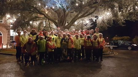 Dereham Runners juniors and seniors in festive mood on Monday. Picture: Club