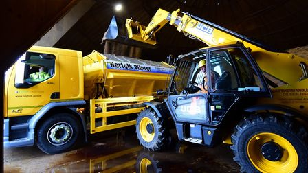 A Norfolk County Highways gritter lorry is loaded up in the salt dome at the depot at Ketteringham.