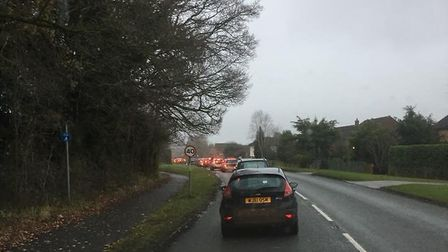 Queues behind the closed section of road on Friday. Photo: Russ Bulmer