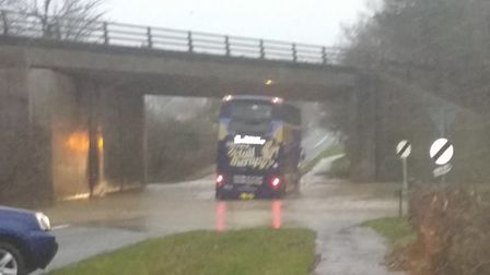 An X1 bus stranded in flood water under the A47 at Scarning. Picture: Michael Protheroe