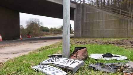 Registration plates and a shoe are among the items that have been left near the A47 bridge at Scarni