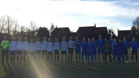 Teams line up for the annual Ben Pyke Memorial game played at Scarning, near Dereham. Picture: Paul