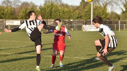 Dereham Town apply pressure during the Boxing Day derby against Norwich United at Aldiss Park. Pictu