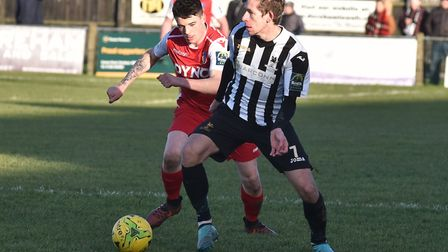 Rhys Logan on the ball for Dereham against Norwich United. Picture: Sonya Duncan