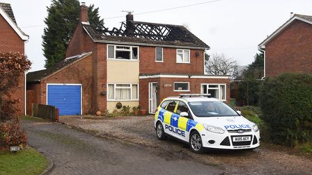 A police car outside the property in Shipdham, gutted by fire on Saturday night. Picture: Ian Burt