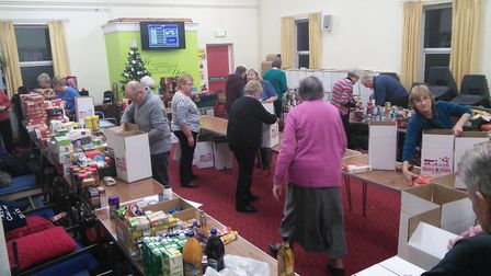 Dereham Salvation Army's production line for packing Christmas food parcels. Picture: Trevor Theoba