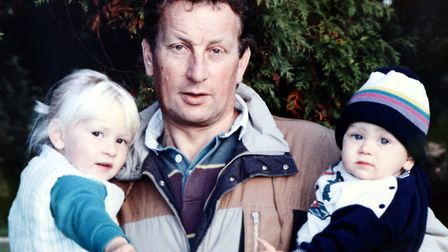 Rosie and Tom Cross with their father Brian, when they were young children. Picture: Matthew Usher.