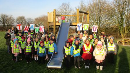 The children thank the donors who made the new playground in Beeston possible. Picture: Parsons&Co