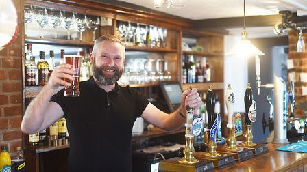 The Queen's Head at Foulsham has been refurbished after last year's fire in May. Pictured is landlor