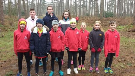 Dereham junior athletes pose for a team picture at the latest cross country grand prix event at Shou