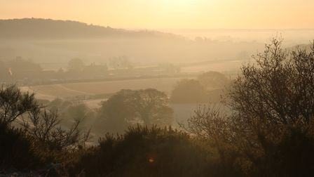 The view from Wiveton Downs on a frosty, misty but sunny sunrise Photo: Martin Sizeland