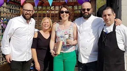Winner Amie Abbs with the Bake Off judges. Picture: Vikki Hunt
