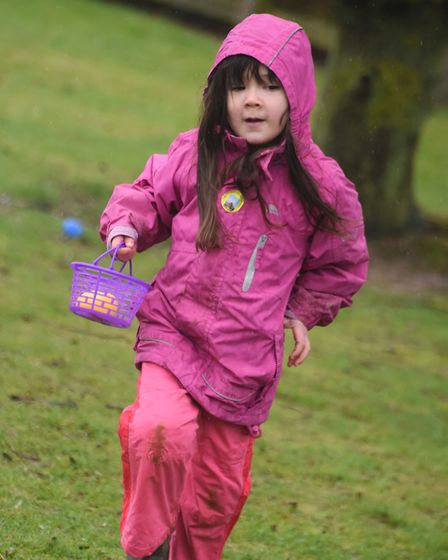 Eggs being collected despite the weather at the Dereham Windmill's annual Easter Egg Hunt. Picture: