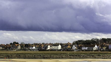 View of the East Quay at Wells, taken from the harbour wall, with an approaching storm overhead Phot