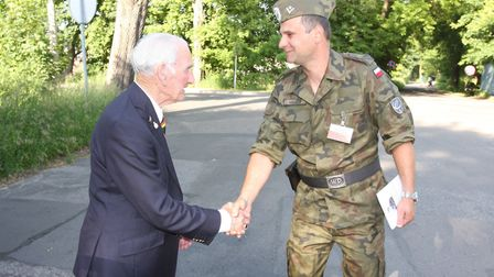 Arthur Brough is thanked by a Polish soldier for all that he and his friends did to help the countr