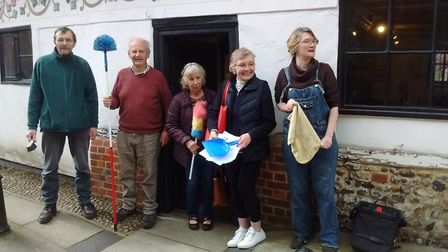 The Dereham Antiquarian Society members giving the town's Bishop Bonner's Cottage Museum a clean in