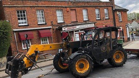 A JCB being recovered from a ram raid at a Post Office in Reepham. Photo: Norfolk Constabulary