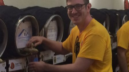 Volunteer Oliver Bunton pouring a pint. Pictures: David Bale