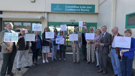 People stood outside of the Breckland Planning Committee to voice their objections to a planning app