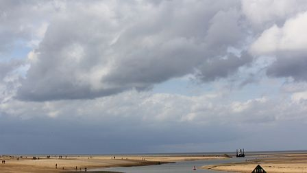 Looking out to the sea from the beach at Wells, under a cloudy sky. Photo: Richard Brunton