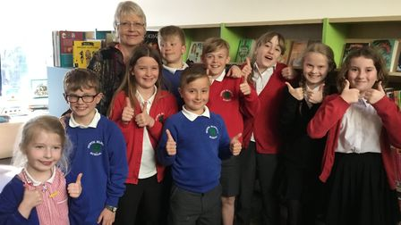 Author Julia Jarman with members of the school council. Picture: North Elmham School