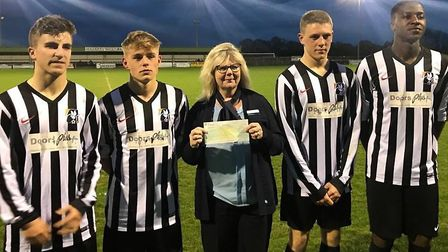 Dereham Education and Soccer Academy cheque presentation with The Nottingham's customer services ass