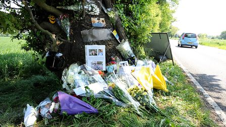 Flowers and tributes have been left at the site of the crash where young motorcyclist Warren Owen di
