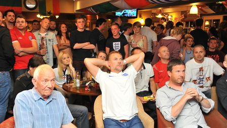 Fans watching an England World Cup match. Photo by Simon Finlay.