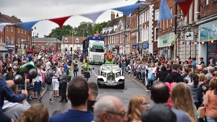The Dereham Carnival parade arrives in the centre of town to cheers from crowds lining the streets.