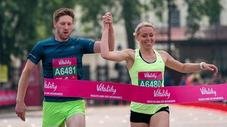 Dani Nimmock and Mark Burgess cross the line hand in hand in London to set a new world record. Pict