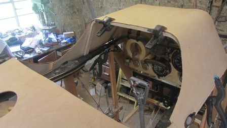 Peter Bond is constructing a Sopwith Camel figher plane in his home workshop. Photo: Peter Bond