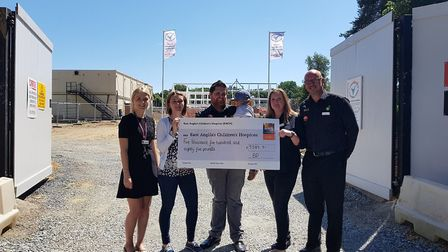 The cheque presentation with EACH's Sophie Mayes, far left, alongside representatives of BP M&S at the nook site. Picture:...